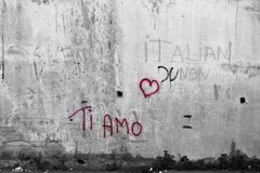 Ti amo, I love you. Sprayed as a red graffiti on a wall in Calabria, southern Italy stock illustration