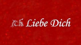 Ti amo il testo in tedesco Ich Liebe Dich si gira verso polvere da sinistra su fondo rosso Immagine Stock Libera da Diritti