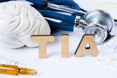 TIA Acronym of afkorting aan medisch concept of diagnose van voorbijgaande ischemische aanval of kleine hersenenslag Word TIA tri royalty-vrije stock foto's