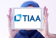 Tiaa organization logo. Logo of tiaa organization on samsung tablet holded by arab muslim woman. tiaa is financial services organization that is the leading Royalty Free Stock Photos