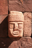 Tiahuanaco stone face. Stone face built into a wall in Tiahuanaco or Tiwanaku, the capital of the Pre-Inca Civilization in Bolivia and Peru Stock Photo