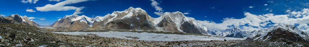 Tian Shan mountains snow peaks long panorama. Tian Shan mountains snow peaks panorama in Kazakhstan and Kyrgyzstan. South Inilchek, Enilchek Khan Tengri and royalty free stock photography