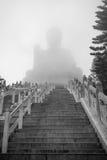 Tian Tan Buddha or Big Buddha in a fog Stock Photo