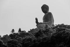 Tian Tan Buddha in Lantau island, Hong Kong. Tian Tan Buddha, also known as the Big Buddha, is a large bronze statue of a Buddha Amoghasiddhi, located at Ngong Royalty Free Stock Images