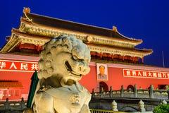 Tiananmen Gate. BEIJING, CHINA - JUNE 27, 2014: A lion statue guards The Tiananmen Gate at Tiananmen Square Royalty Free Stock Photo