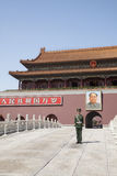 Tiananmen Square, Gate of Heavenly Peace with Mao's Portrait and guard, Beijing, China. Stock Photos