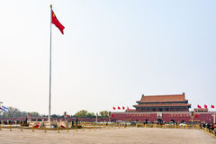 Tiananmen Square with guard of honor near Flag. BEIJING, CHINA - MARCH 19, 2017: view of Tiananmen Square with guard of honor near the national Flag, people and Stock Image