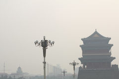 Tiananmen tower enveloped by the heavy fog and haze. Air pollution and poor air quality as the development of industry stock photos