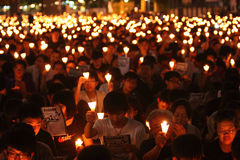Tiananmen Vigil in Hong Kong. 150,000 people converged on Victoria Park to mark the 22nd anniversary of the bloody crackdown on pro-democracy protesters in Royalty Free Stock Photo