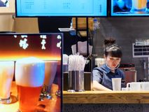 Free TIANJIN, CHINA - 7 OCT 2019 - Asian Chinese Bubble Tea Stall Employee Prepares A Drink For Customers Royalty Free Stock Image - 164562586