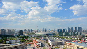 Tianjin,China - June 26,2016 :Time lapse Cityscape of Tianjin city China at daytime with moving cloud on sky. stock video footage