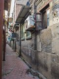 Traditional old neighborhood in Tianjin French concession. Tianjin, China - September 2017: Traditional neighborhood lined with airconditioning equipment in the stock photography