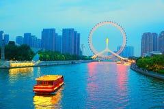 Tianjin cityscape, China. Tianjin Haihe River and Tianjin Eye ferries wheel at night view Stock Photo