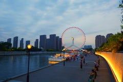 Tianjin cityscape, China. Tianjin Haihe River and Tianjin Eye ferries wheel at night view Royalty Free Stock Photo