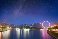 Tianjin city skyline and star trail, China