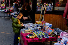Tianjin Italian style,China. Visitors to the Italian style street are choosing goods Stock Image