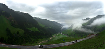 The Tianshan concept of cloud - cloud floating in the mountains. Crossing the Don does not pull the mountains and the rain, the hope of the people at the top of Royalty Free Stock Image