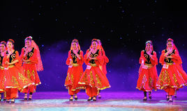 The Tianshan Mountains visitors-Xinjiang national Dance-The campus show Stock Images