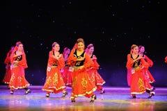 The Tianshan Mountains visitors-Xinjiang national Dance-The campus show Stock Photos