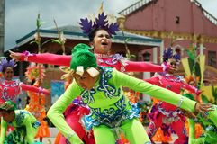 A group of street dancers in various costumes dance at church plaza. Tiaong, Quezon, Philippines - June 22, 2016: a group of street dancers in various costumes Royalty Free Stock Photos