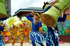 A group of street dancers in various costumes dance at church plaza. Tiaong, Quezon, Philippines - June 22, 2016: a group of street dancers in various costumes Royalty Free Stock Images