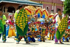 A group of street dancers in various costumes dance at church plaza. Tiaong, Quezon, Philippines - June 22, 2016: a group of street dancers in various costumes Stock Image