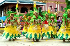 A group of street dancers in various costumes dance at church plaza. Tiaong, Quezon, Philippines - June 22, 2016: a group of street dancers in various costumes Royalty Free Stock Photo