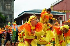 A group of street dancers in various costumes dance at church plaza. Tiaong, Quezon, Philippines - June 22, 2016: a group of street dancers in various costumes Stock Photography