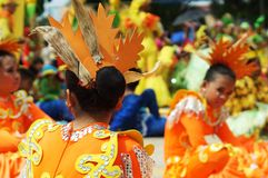 Head dress of Sitting participant in diverse costumes of street dancer. Tiaong, Quezon, Philippines - June 22, 2016: Sitting participant in diverse costumes of Stock Image