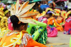 Head dress of Sitting participant in diverse costumes of street dancer. Tiaong, Quezon, Philippines - June 22, 2016: Sitting participant in diverse costumes of Stock Images