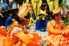 Head dress of Sitting participant in diverse costumes of street dancer. Tiaong, Quezon, Philippines - June 22, 2016: Sitting participant in diverse costumes of Royalty Free Stock Photos