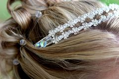 Tiara. Bride with a silver tiara and beads in her hair for decoration Stock Photography