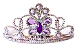 Tiara. Silver color tiara with purple and lilac stones and pearls isolated on white background Royalty Free Stock Image