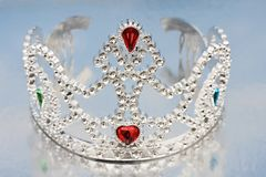 Tiara. On mirrored blue background Royalty Free Stock Photography