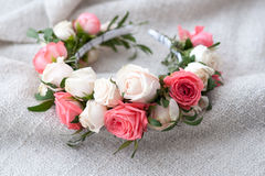 Tiara of artificial roses on wooden background Stock Image