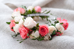 Tiara of artificial roses on wooden background. Stock Photography