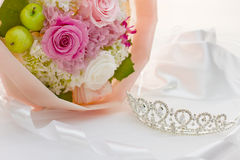 Tiara and bouquet Stock Images