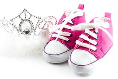 Tiara crown and baby shoes Royalty Free Stock Image