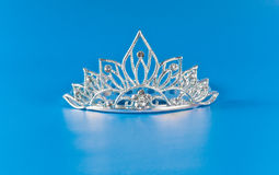 Tiara or diadem with reflection on blue Stock Image