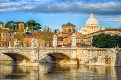 Tiber bridge and Dome of Vatican cathedral, Rome, Italy Stock Images