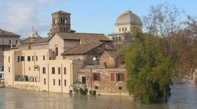 Tiber island in the center of Rome with the tall water of the river Tiber around. Italy royalty free stock images