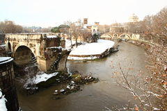 The Tiber Island covered by snow. The Tiber island in the middle of Rome covered by snow, a really rare event in the City stock photo