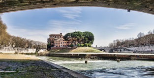 The Tiber Island in the Tiber. River, which runs through Rome royalty free stock images