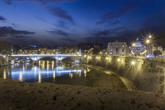 Tiber, night view at St. Peter's cathedral in Rome, Italy Stock Photos