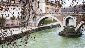 Tiber River and bridge to Isola Tiberina. Travel to Italy - view of Tiber River and Ponte Fabricio bridge pons fabricius, ponte dei quattro capi to Isola royalty free stock photos