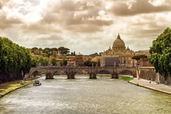 Tiber river, Ponte Sant'Angelo and St. Peter's cathedral, Roma, Italy Stock Images