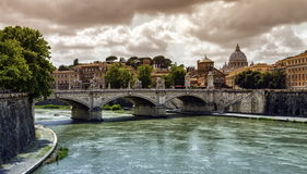 Tiber river, Ponte Sant`Angelo and St. Peter`s cathedral, Roma, Italy. Tiber river, Ponte Sant`Angelo and St. Peter`s cathedral by cloudy day, Roma, Italy stock photo