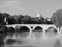 Tiber river in Rome. Black and white view of the Tiber River, Sisto bridge and the dome of St. Peter. Rome, Italy royalty free stock images