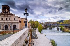 Tiber River Rome, Italy. Rome, Italy - April 4, 2019: Ancient buildings and bridges around Tiber River in Rome, Italy royalty free stock photo