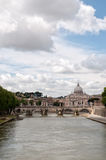 The Tiber River with St. Peters Basilica in the ba Royalty Free Stock Images